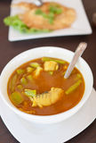 Thai style curry prepared with fish and healthy ve Stock Photo