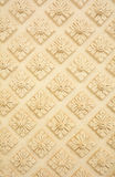 Thai style decorative flora pattern molding on wall Stock Photo