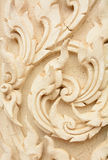 Thai style decorative pattern molding on temple wall Royalty Free Stock Image