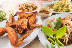 Thai style deep fried chicken with thai papaya salad Royalty Free Stock Images