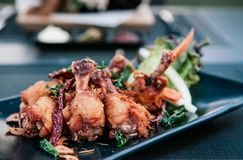 Thai style deep fried chicken wings, chicken drums with herbs, g. Thai style deep fried chicken wings, chicken drums with herbs, chilli, garlic and vegetable on Royalty Free Stock Images