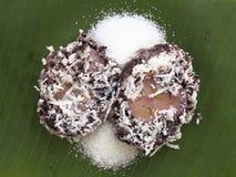 Thai style dessert. Steam black glutinous rice wrap up cultivated banana Stock Photo