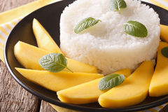 Thai style dessert, glutinous rice eat with mangoes closeup. Hor Royalty Free Stock Image