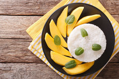 Thai style dessert, glutinous rice eat with mangoes closeup. hor Royalty Free Stock Photography