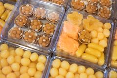 Thai style desserts in plastic boxes. Close up of Thai dessert royalty free stock image