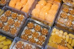 Thai style desserts in plastic boxes. Close up of Thai dessert stock photography