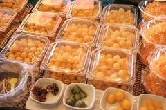 Thai style desserts in plastic boxes. Close up of Thai dessert royalty free stock photo