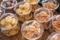 Thai style desserts in plastic boxes. Close up of Thai dessert stock photos