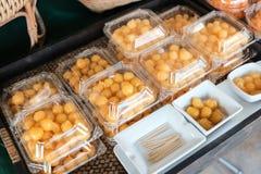 Thai style desserts in plastic boxes. Thai style desserts in plastic boxes in the street market royalty free stock photos