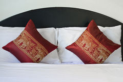 Thai style elephant pattern pillows on bed Royalty Free Stock Photo