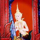Thai-style fine art on a temple wall Royalty Free Stock Photo