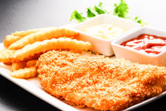 Thai style fish and chips. Served with ketchup and tartare sauce Stock Image