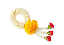 Thai style flower garland. Made of jasmine, marigold, crown flower and rose isolated on white background Stock Photo