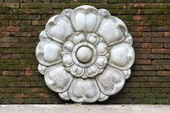 Thai style flower stucco on old brick wall.  Royalty Free Stock Image