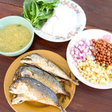 Thai style food. Fried mackerel fish serving with fresh salad , rice noodle and spicy dressing sauce.The name is Meang. food wrapp Royalty Free Stock Images