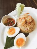Thai style food, fried rice with chili paste and shrimp and boil. Fried rice with chili paste topped with shrimp and boiled egg, Thai food - vintage filter Stock Photo