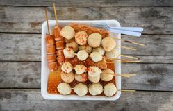 Thai style food of grilled sausage hotdog meat ball and fish ball in stick on tray royalty free stock photos