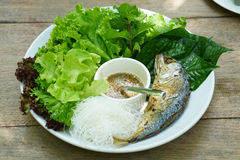 Thai style fried mackerel fish serving with fresh salad and spic Royalty Free Stock Photos