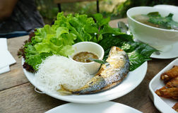 Thai style fried mackerel fish serving with fresh salad and spic Stock Images