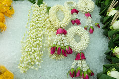 Thai style garland on ice. At flower market in Thailand Stock Photo