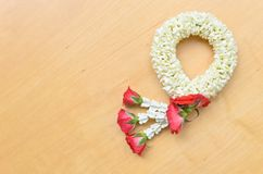 Thai style garland on wood background Stock Photos