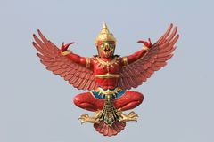 Thai style GARUDA. The god of bird Garuda in Thai style with blue background Royalty Free Stock Photo