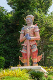 Thai style giant statue in temple Stock Photo