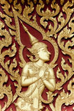 Thai style gloden Deva carving on wood Stock Photos