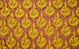 Thai Style Gold Wall Pattern. Thai Style art pattern on a wall in public temple Royalty Free Stock Photography