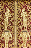 Thai style golden deva carving on wood Stock Images