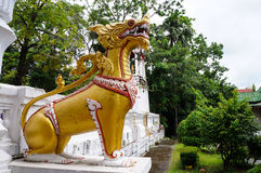 Thai style golden lion. In the temple of Thailand Stock Photos