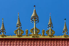 Thai style golden statue on the roof temple Royalty Free Stock Image