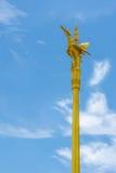 Thai style golden swan statue on golden pillar of public temple Royalty Free Stock Photos