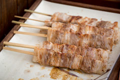 Thai style grill pork in bamboo stick Stock Photo