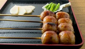 Thai Style Grilled Sausages on Bamboo Skewer Stock Photo