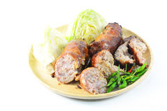 Thai style Grilled sausages in dish and Cucumber Royalty Free Stock Photos