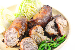 Thai style Grilled sausages in dish and Cucumber Stock Photography