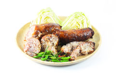 Thai style Grilled sausages in dish and Cucumber Stock Images