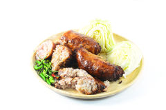 Thai style Grilled sausages in dish and Cucumber Royalty Free Stock Images