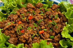 Thai-style Ground Beef. Dish with lettuce Royalty Free Stock Image