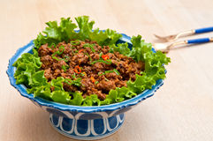 Thai-style Ground Beef. Dish with lettuce Stock Images