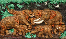 Thai style handcraft of elephants on wall. Stock Image