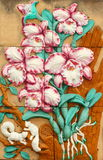 Thai style handcraft of orchid  on wall. Royalty Free Stock Photos
