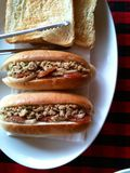 Thai style hot dog food. Thai style hot dog with mince pork and toast bread food in white plate Stock Photo