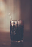 Thai style ice black coffee at blur background , color vintage s Royalty Free Stock Photo