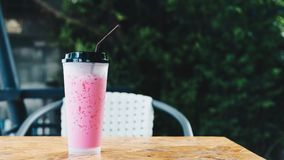 Thai style iced pink sweet milk in coffee shop Royalty Free Stock Images