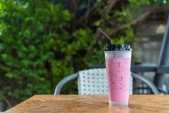 Thai style iced pink sweet milk in coffee shop Stock Photo