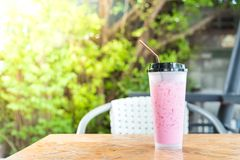 Thai style iced pink sweet milk in coffee shop Royalty Free Stock Photography