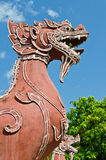 Thai style lion statue with blue sky Stock Photos