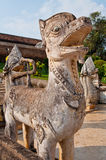 Thai style lion statue with blue sky Stock Photo